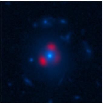 Nell'immagine, la luce (in rosso) proveniente da una delle galassie osservate da ALMA grazie al lensing gravitazionale. Si può notare la tipica deformazione in archi di luce, noti come anelli di Einstein, dovuta a un'altra galassia (qui in blu da un'immagnie di HST) posta a metà strada. Crediti: Vieira et al., ALMA (ESO, NAOJ, NRAO), NASA, NRAO/AUI/NSF