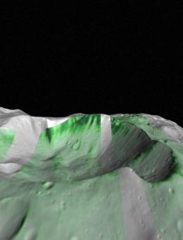 L'olivina, un materiale comune nelle rocce del mantello dei pianeti interni del Sistema solare, è stata individuata su Vesta con l'analisi dei dati iperspettrali raccolti dallo strumento VIR a bordo della sonda Dawn. Nell'immagine, in verde sono indicati gli affioramenti di olivina all'interno del cratere Bellicia. Crediti: immagine generata da Alessandro Frigeri ed Eleonora Ammannito combinando i dati dello spettrometro VIR e le immagini della Framing Camera a bordo di Dawn.