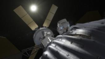 Elaborazione artistica di un astronauta che raccoglie campioni dall'asteroide catturato dalla missione ARM. Crediti: NASA