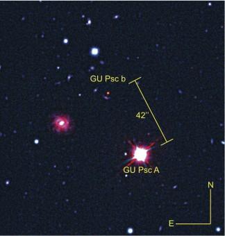 Immagine composita dell'esopianeta GU Psc b e della sua stella nelle bande della radiazione visibile e infrarossa ottenute dai telescopi Gemini South e CFHT.Crediti: Universite de Montreal