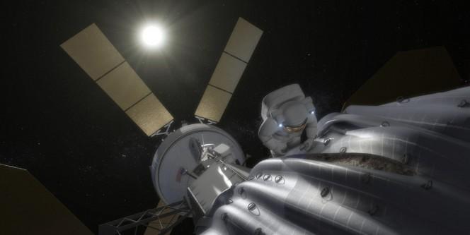 L'illustrazione mostra come in un immediato futuro un astronauta potrebbe prelevare campioni da un asteroide agganciato e spostato in un'orbita stabile attorno alla Terra o alla luna. Crediti: NASA.