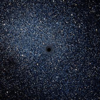 Rappresentazione artistica di un buco nero all'interno di una galassia nana.  Crediti: ESA/ATG medialab