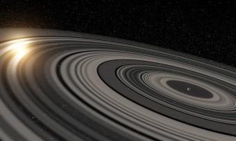 Una visione artistica del sistema di anelli che circonda l'oggetto celeste denominato J1407b, un pianeta gigante o forse una nana bruna. Gli anelli stanno eclissando la giovane stella di tipo solare J1407. Crediti: Ron Miller