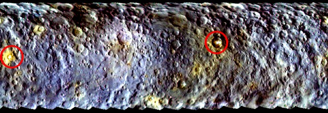 Una mappa a falsi colori  della superficie di Cerere catturara dalla sonda Dawn e realizzata per mettere in risalto le differenze di colore della superficie. Nei due cerchi, le due macchie luminose Spot 1 (a sinistra) e Spot 5 (a destra). Crediti: NASA/JPL-Caltech/UCLA/MPS/DLR/IDA