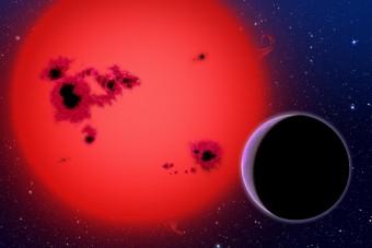 Rappresentazione artistica di una stella nana rossa e, in primo piano di un esopianeta in orbita attorno ad essa. Crediti: David A. Aguilar (CfA/Harvard-Smithsonian)