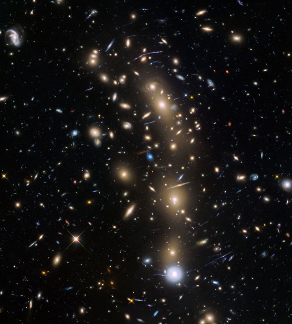 This image from the NASA/ESA Hubble Space Telescope shows the galaxy cluster MACS J0416.1–2403. This is one of six being studied by the Hubble Frontier Fields programme, which together have produced the deepest images of gravitational lensing ever made. Due to the huge mass of the cluster it is bending the light of background objects, acting as a magnifying lens. Astronomers used this and two other clusters to find galaxies which existed only 600 to 900 million years after the Big Bang.
