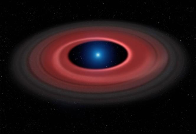 Questa rappresentazione artistica mostra come un asteroide, distrutto dall'enorme forza di gravità di una nana bianca, abbia formato un anello di particelle di polvere e altri detriti in orbita intorno al nucleo stellare spento, di dimensioni pari a quelle della Terra: SDSS J1228+1040. Il gas prodotto dalle collisioni all'interno del disco viene rilevato dalle osservazioni effettuate nell'arco di dodici anni con il VLT dell'ESO e si mostra in un sottile arco luminoso. Crediti: Mark Garlick (www.markgarlick.com) and University of Warwick/ESO