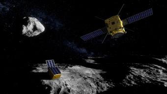In questa illustrazione: il micro-lander della missione ESA Asteroid Impact Mission appoggiato sul corpo minore (170 metri di diametro) dell'asteroide binario Didymos. Sullo sfondo si scorge il corpo principale, grande circa 800 metri. Crediti: ESA - ScienceOffice.org
