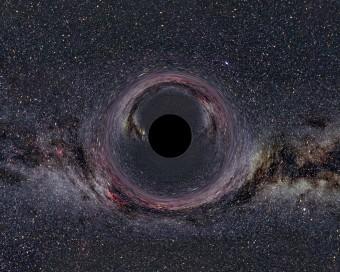 Rappresentazione artistica di un buco nero sovrapposto alla Via Lattea