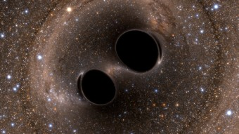 Rappresentazione artistica della coalescenza di due buchi neri. Crediti: LIGO