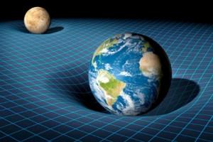 """La curvatura dello spazio generata da una massa nei suoi dintorni fa sì che altre masse nelle vicinanze cadano nella """"buca"""" od orbitino attorno a essa"""