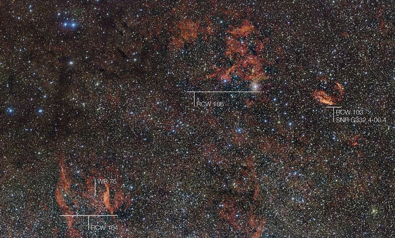 Si vedono molti oggetti interessanti in questa immagine a grande campo, come per esempio i filamenti sulla destra sono i resti dell'antica supernova SNR G332.4-00.4, nota anche come RCW 103, mentre i filamenti rossi luminosi in basso a sinistra circondano una stella insolita molto calda: si tratta di RCW 104, che circonda la stella di tipo Wolf–RayetWR 75. Brandelli di polvere scura cancellano qua e là la luce delle stelle in questo paesaggio cosmico. Crediti: ESO