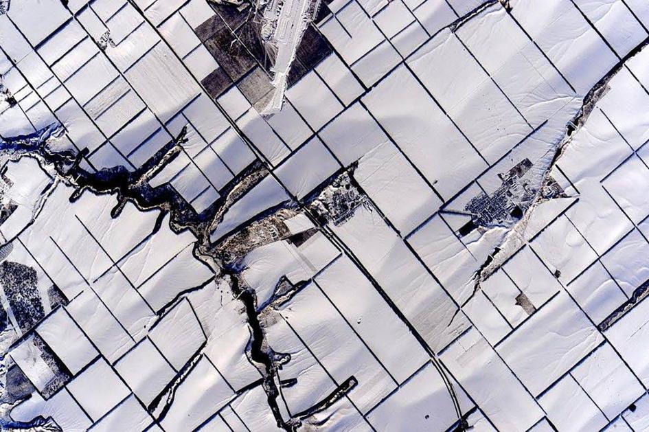 Terreni agricoli coperti di neve nella regione di Novopersianovka, nel sudest della Russia. Crediti: Scott Kelly/NASA