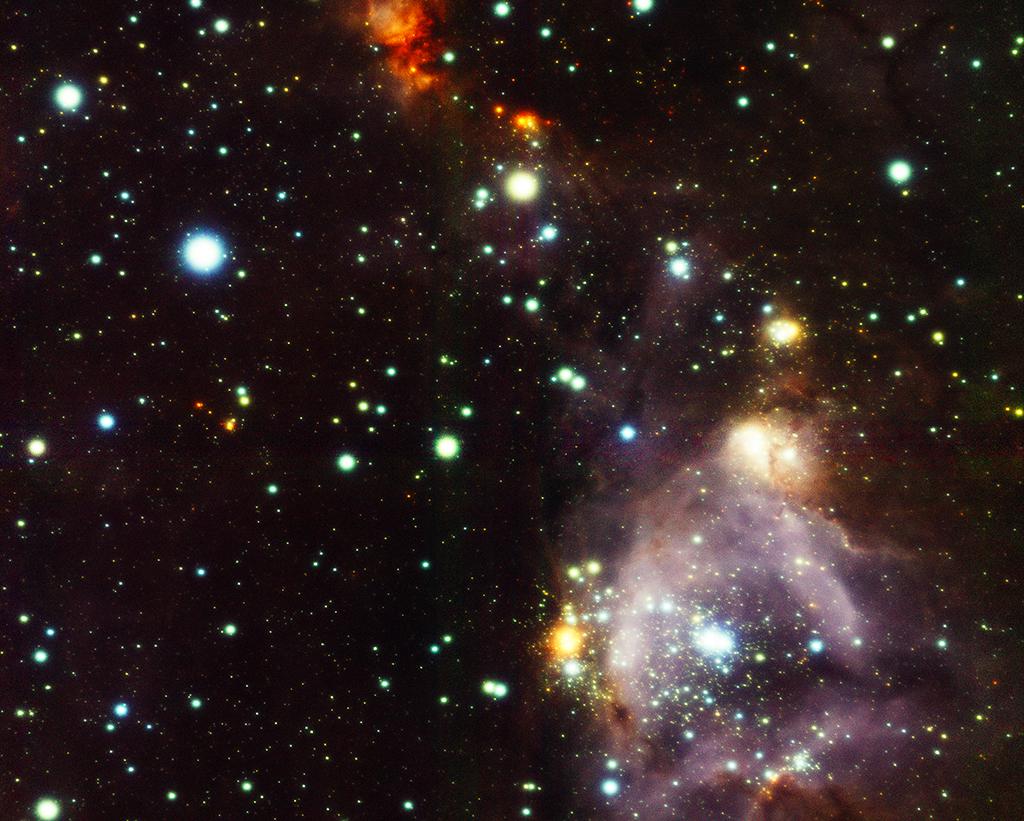 L'immagine è stata ottenuta da GeMS/GSAOI del telescopio Gemini South nel vicino infrarosso: si tratta del gruppo di formazione stellare N159W nella Grande Nube di Magellano. L'immagine si estende per 1,5 minuti d'arco ed è un composto di tre filtri (J, H, e KS). Crediti: Gemini Observatory / AURA