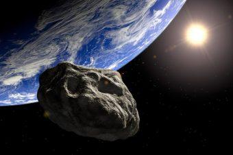 Immagine d'artista di un asteroide con il nostro pianeta sullo sfondo. Crediti: NASA