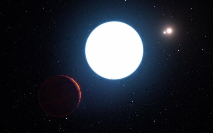 Questa rappresentazione artistica mostra una veduta del sistema stellare triplo HD 131399 da un punto vicino al pianeta gigante in orbita nel sistema. Il pianeta, visibile nell'angolo in basso a sinistra nell'immagine, si chiama HD 131399Ab. Crediti: ESO/L. Calçada