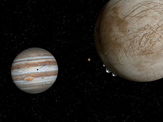 Rappresentazione artistica Questo è il concetto di un artista della luna Europa, a destra, con pennacchi di acqua-ghiaccio eruzione dal suo arto inferiore sinistro nella posizione ore 7. Sullo sfondo, a sinistra, è arancione di Jupiter, luna vulcanica Io, ea sinistra di Io è Jupiter. l'ombra di Io appare al centro della faccia di Giove, a sinistra. Crediti: NASA, ESA, and G. Bacon (STScI)